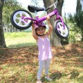 Cruzee-Balance-Bike-Purple-with-White-Wheels-Lift.jpg